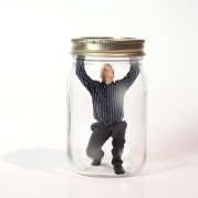 Man trapped in a jar.